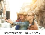couple enjoying outdoors in a... | Shutterstock . vector #403277257