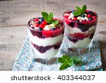 healthy layered dessert with... | Shutterstock . vector #403344037