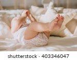 photo of newborn baby feet | Shutterstock . vector #403346047