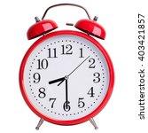 Red Alarm Clock Shows Half Of...