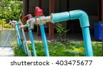 blue water tab in garden | Shutterstock . vector #403475677