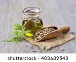 hemp oil n a glass jar and hemp ...   Shutterstock . vector #403639543