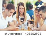 four teenagers are sitting in a ... | Shutterstock . vector #403662973