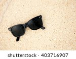 top view of sunglasses on the...   Shutterstock . vector #403716907