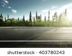 asphalt road in forest | Shutterstock . vector #403780243