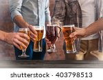 male group clinking glasses of... | Shutterstock . vector #403798513