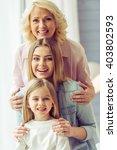 portrait of three generations... | Shutterstock . vector #403802593