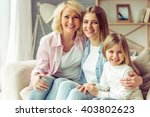 granny  her daughter and...   Shutterstock . vector #403802623