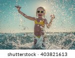 happy child playing in the sea. ... | Shutterstock . vector #403821613