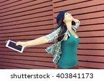 funny girl listening to the... | Shutterstock . vector #403841173