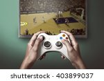 hand holding game console... | Shutterstock . vector #403899037
