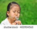 girl with dandelion fluff   Shutterstock . vector #403904563