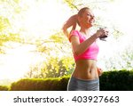 fit young woman running ... | Shutterstock . vector #403927663