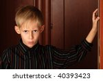angry six year old boy standing ... | Shutterstock . vector #40393423