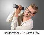 funny weak man tries to lift a... | Shutterstock . vector #403951147