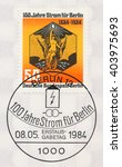 Small photo of ST. PETERSBURG, RUSSIA - APR 10, 2016: A postmark printed in Berlin, Germany, shows Electricity Centenary. Allegorical figure holding light bulb (symbol of electric power), circa 1984