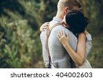 groom gently embracing his...   Shutterstock . vector #404002603
