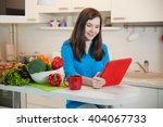 woman using a tablet computer... | Shutterstock . vector #404067733