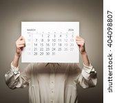 woman is holding march calendar ...   Shutterstock . vector #404098807