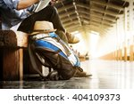 backpack and hat at the train... | Shutterstock . vector #404109373