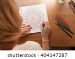overhead view of woman drawing... | Shutterstock . vector #404147287