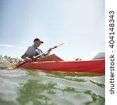 Shot Of Senior Man Kayaking On...