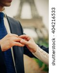 groom puts ring on a brides... | Shutterstock . vector #404216533