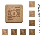 set of carved wooden bitcoins...