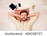 Portrait Of Happy Man Lying On...