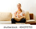 young woman watching tv and... | Shutterstock . vector #404295703