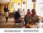 customers at tables and... | Shutterstock . vector #404441953