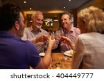four friends making a toast... | Shutterstock . vector #404449777