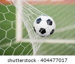 soccer ball in goal net with... | Shutterstock . vector #404477017