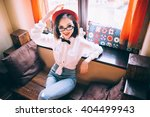 pretty girl with red hat sits... | Shutterstock . vector #404499943