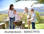 family having barbecue lunch in ... | Shutterstock . vector #404517973