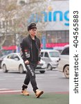 Small photo of YIWU-CHINA-JAN. 8, 2016. Fashionable young man on the street. About 30 million more men than women will reach adulthood and enter China's mating market by 2020, caused by widespread female abortion.