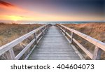 wooden path at baltic sea over... | Shutterstock . vector #404604073