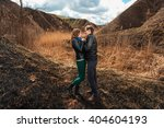 happy couple smiling outdoors... | Shutterstock . vector #404604193