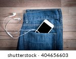 White Phone In Jeans Pocket On...