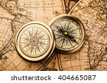 old compass on vintage map.... | Shutterstock . vector #404665087