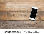 smart phone on wooden table... | Shutterstock . vector #404692363