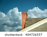 Part Of Tiled Roof With Brick...