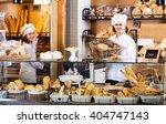 helpful bakery staff offering... | Shutterstock . vector #404747143