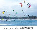 kitesurfers enjoying wind power ... | Shutterstock . vector #404798497