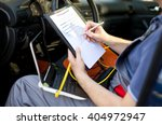 mechanic writing on clipboard ... | Shutterstock . vector #404972947