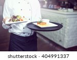 waiters carrying plates with... | Shutterstock . vector #404991337