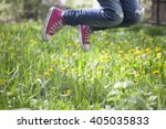 jumping on blossom meadow   Shutterstock . vector #405035833