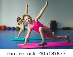 girls doing gymnastic exercises ...