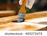 Painter Holding A Paintbrush...