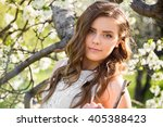 young beautiful girl in a white ... | Shutterstock . vector #405388423